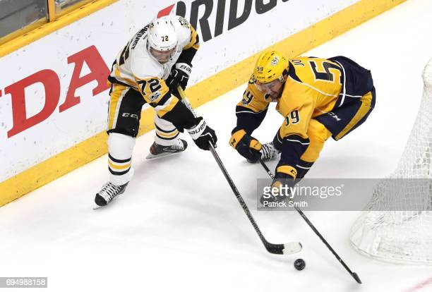 Patric Hornqvist of the Pittsburgh Penguins and Roman Josi of the Nashville Predators battle for the puck during the first period in Game Six of the...