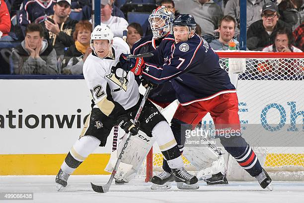 Patric Hornqvist of the Pittsburgh Penguins battles for position with Jack Johnson of the Columbus Blue Jackets on November 27 2015 at Nationwide...