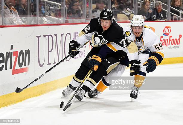 Patric Hornqvist of the Pittsburgh Penguins battles for the puck against Roman Josi of the Nashville Predators at Consol Energy Center on February 1...