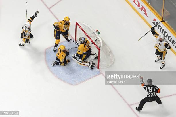Patric Hornqvist of the Pittsburgh Penguins celebrates after scoring the gamewinning goal past goalie Pekka Rinne of the Nashville Predators in the...