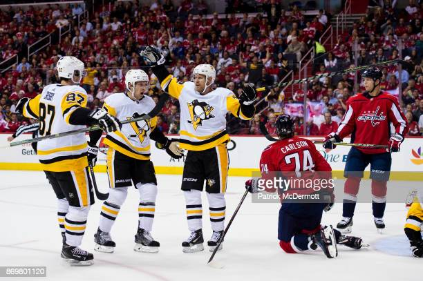 Patric Hornqvist of the Pittsburgh Penguins celebrates after scoring a goal against the Washington Capitals in the second period at Capital One Arena...