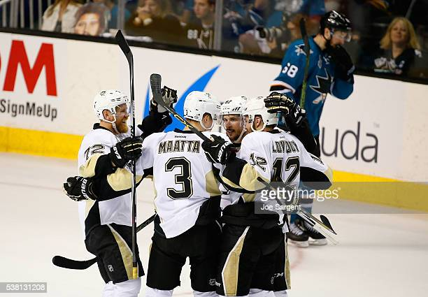 Patric Hornqvist of the Pittsburgh Penguins celebrates his second period goal with teammates Olli Maatta Sidney Crosby and Ben Lovejoy of the...