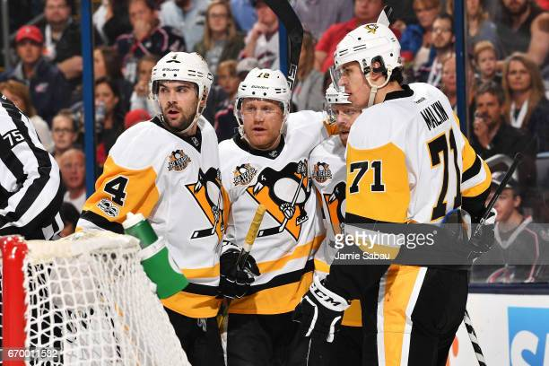 Patric Hornqvist of the Pittsburgh Penguins celebrates his second period goal with Justin Schultz Phil Kessel and Evgeni Malkin of the Pittsburgh...