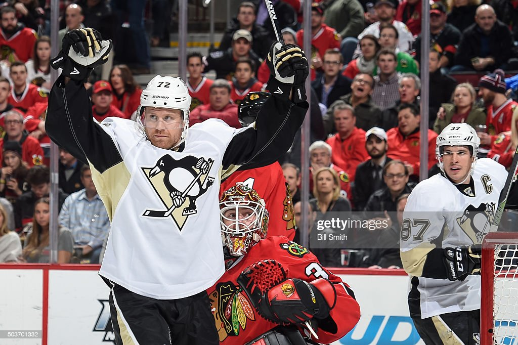 Patric Hornqvist #72 of the Pittsburgh Penguins celebrates in front of goalie Scott Darling #33 of the Chicago Blackhawks, as Sidney Crosby #87 reacts behind, after the Penguins scored against the Blackhawks in the second period of the NHL game at the United Center on January 6, 2016 in Chicago, Illinois.