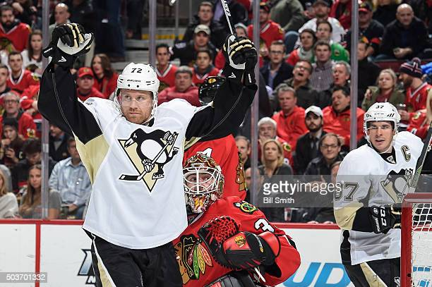 Patric Hornqvist of the Pittsburgh Penguins celebrates in front of goalie Scott Darling of the Chicago Blackhawks as Sidney Crosby reacts behind...