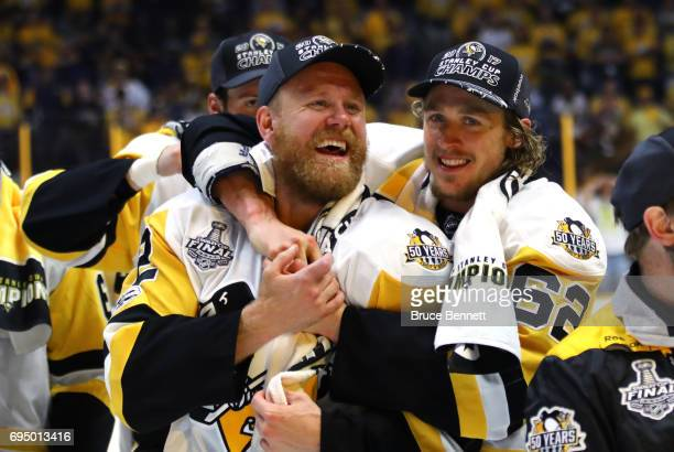 Patric Hornqvist of the Pittsburgh Penguins celebrates with Carl Hagelin after defeating the Nashville Predators 20 in Game Six of the 2017 NHL...