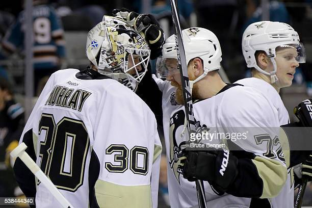 Patric Hornqvist of the Pittsburgh Penguins celebrates with Matt Murray after defeating the San Jose Sharks 31 in Game Four of the 2016 NHL Stanley...