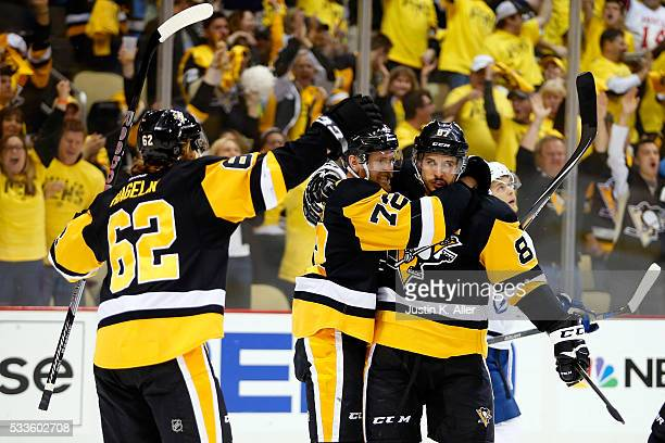Patric Hornqvist of the Pittsburgh Penguins celebrates with Sidney Crosby and Carl Hagelin after scoring a goal on Andrei Vasilevskiy of the Tampa...
