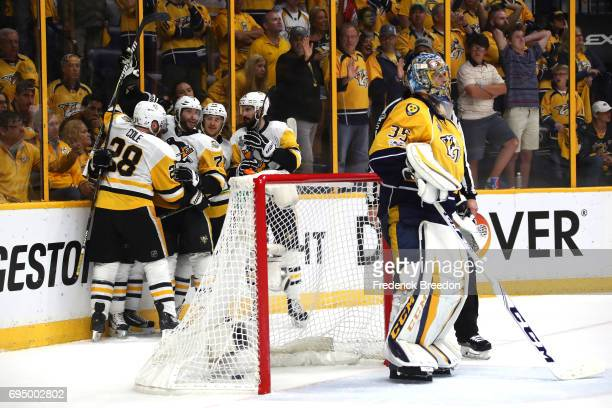 Patric Hornqvist of the Pittsburgh Penguins celebrates with teammates after scoring a goal against the Nashville Predators during the third period in...