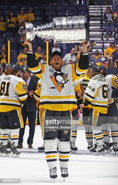 Patric Hornqvist of the Pittsburgh Penguins celebrates with the Stanley Cup trophy after defeating the Nashville Predators 20 in Game Six of the 2017...