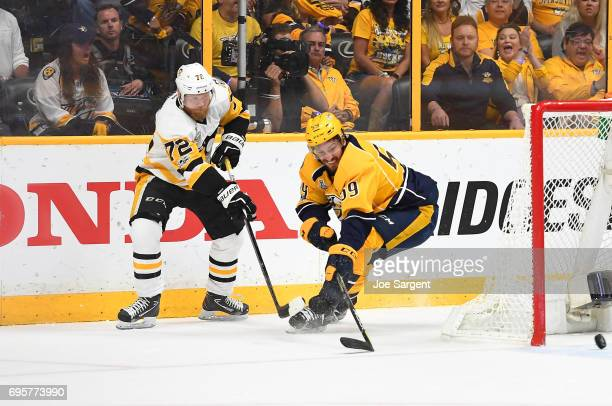 Patric Hornqvist of the Pittsburgh Penguins centers the puck past Roman Josi of the Nashville Predators in the first period of Game Six of the 2017...
