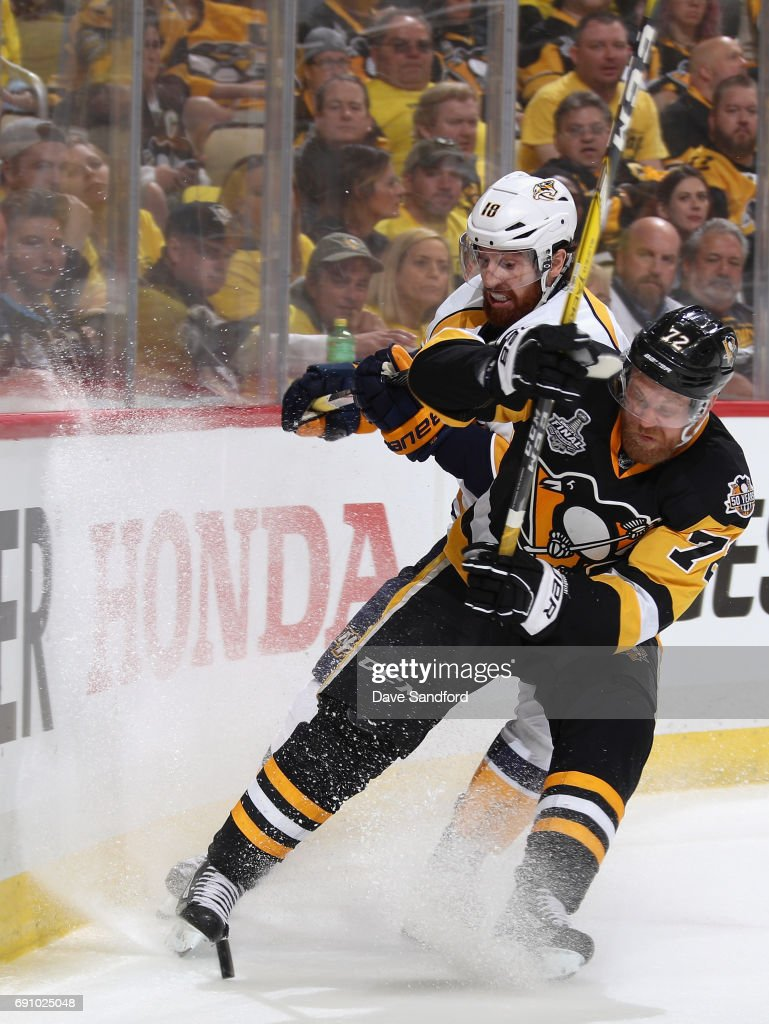 Patric Hornqvist #72 of the Pittsburgh Penguins collides with James Neal #18 of the Nashville Predators at the boards during the third period of Game Two of the 2017 NHL Stanley Cup Final at PPG Paints Arena on May 31, 2017 in Pittsburgh, Pennslyvannia.