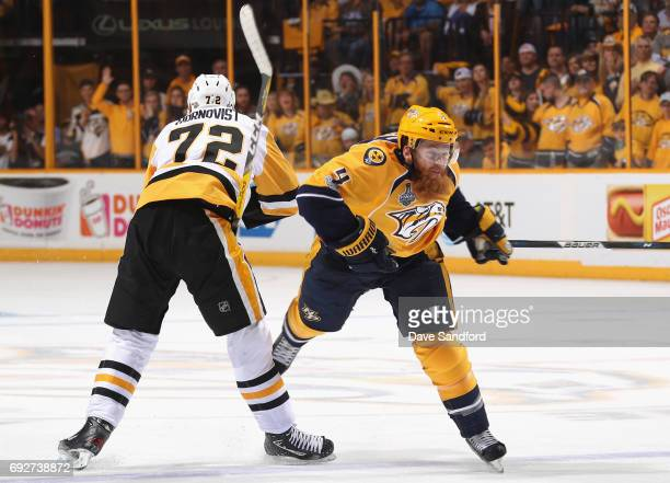 Patric Hornqvist of the Pittsburgh Penguins gets called for tripping Ryan Ellis of the Nashville Predators during the first period of Game Four of...