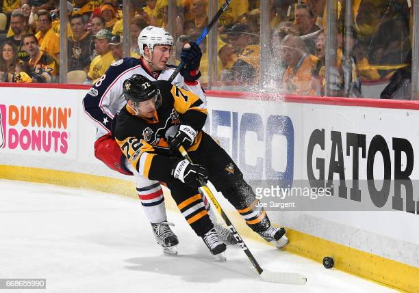 Patric Hornqvist of the Pittsburgh Penguins handles the puck in front of Zach Werenski of the Columbus Blue Jackets in Game Two of the Eastern...