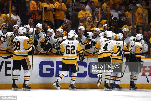 Patric Hornqvist of the Pittsburgh Penguins high fives teammates after scoring a goal against the Nashville Predators during the third period in Game...