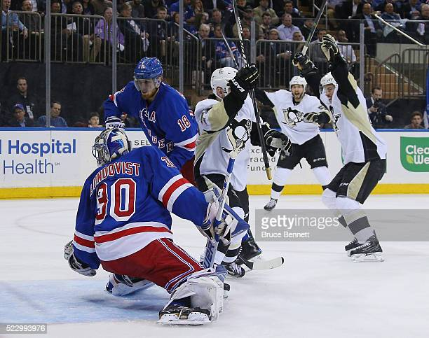 Patric Hornqvist of the Pittsburgh Penguins scores a powerplay goal at 711 of the first period against Henrik Lundqvist of the New York Rangers and...