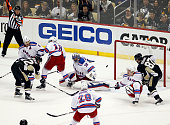 Patric Hornqvist of the Pittsburgh Penguins scores in the third period against Henrik Lundqvist of the New York Rangers in Game Three of the Eastern...