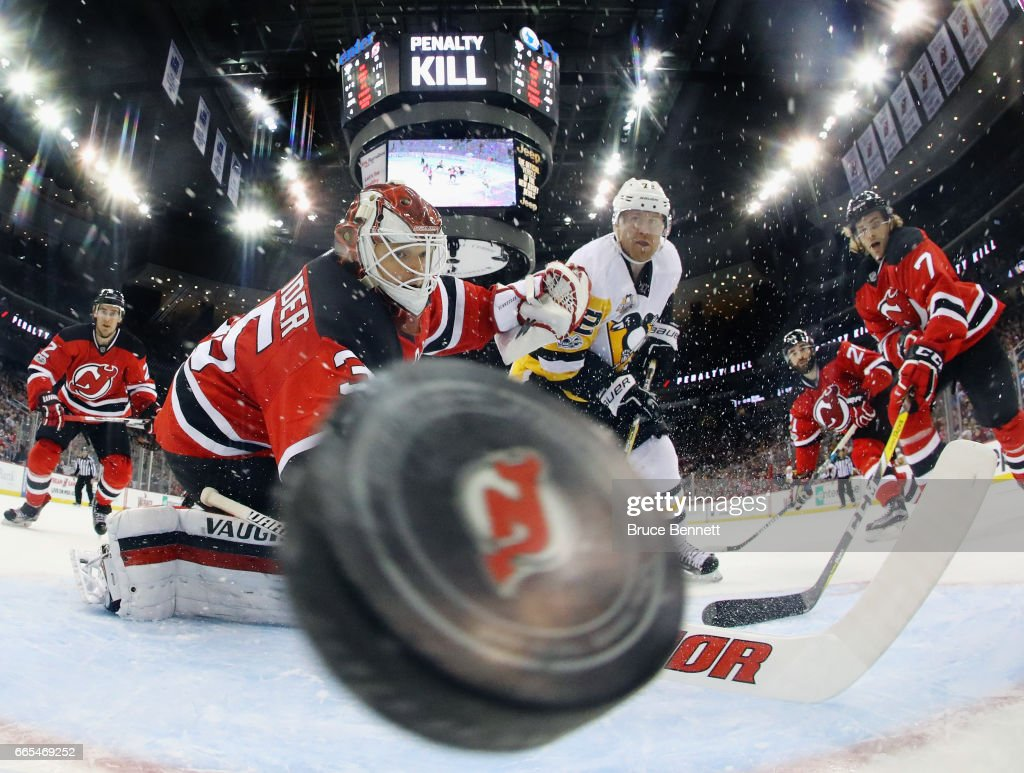Patric Hornqvist #72 of the Pittsburgh Penguins scores on the powerplay at 7:45 of the second period against Cory Schneider #35 of the New Jersey Devils at the Prudential Center on April 6, 2017 in Newark, New Jersey.