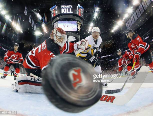 Patric Hornqvist of the Pittsburgh Penguins scores on the powerplay at 745 of the second period against Cory Schneider of the New Jersey Devils at...