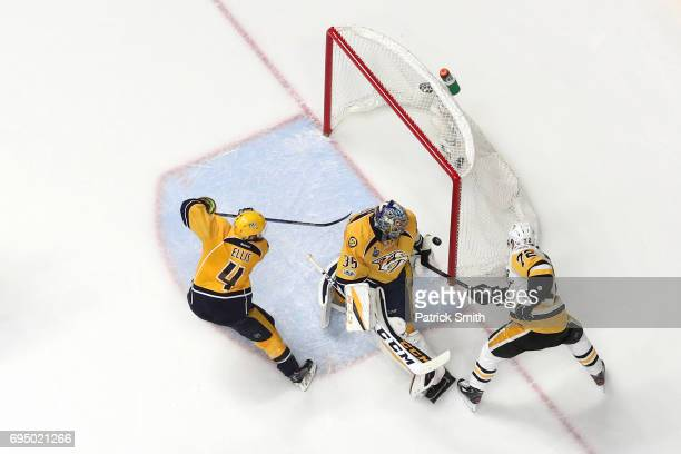 Patric Hornqvist of the Pittsburgh Penguins scores the gamewinning goal past goalie Pekka Rinne of the Nashville Predators in the third period in...