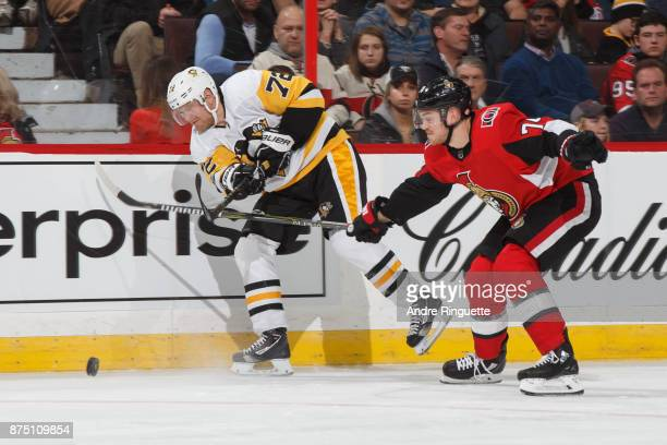 Patric Hornqvist of the Pittsburgh Penguins shoots the puck against Mark Borowiecki of the Ottawa Senators at Canadian Tire Centre on November 16...