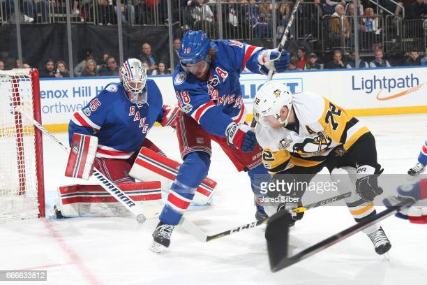 Patric Hornqvist of the Pittsburgh Penguins shoots the puck on net against Magnus Hellberg of the New York Rangers at Madison Square Garden on April...