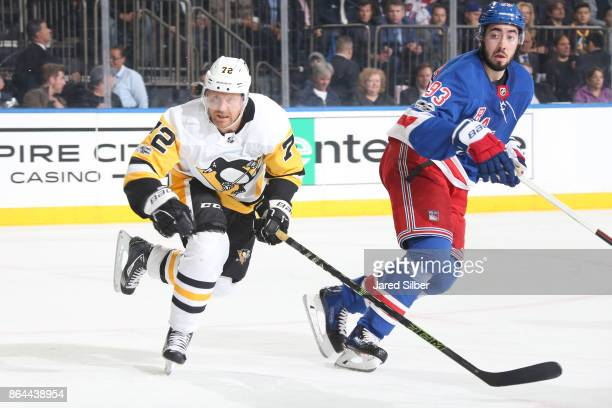 Patric Hornqvist of the Pittsburgh Penguins skates against Mika Zibanejad of the New York Rangers at Madison Square Garden on October 17 2017 in New...