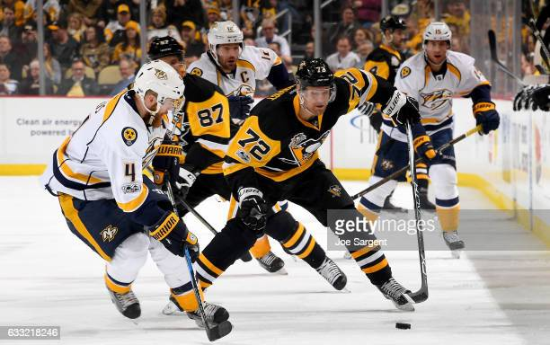 Patric Hornqvist of the Pittsburgh Penguins skates against Ryan Ellis of the Nashville Predators at PPG Paints Arena on January 31 2017 in Pittsburgh...