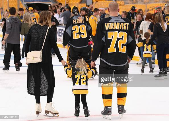 Patric Hornqvist of the Pittsburgh Penguins skates with his wife Malin and daughter Isabella during the family skate as part of the 2017 Coors Light...