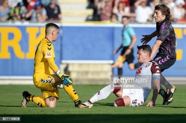 Patric Klandt of SC Freiburg saves on Andrea Belotti of Torino FC during the preseason friendly football match between SC Freiburg and Torino FC...