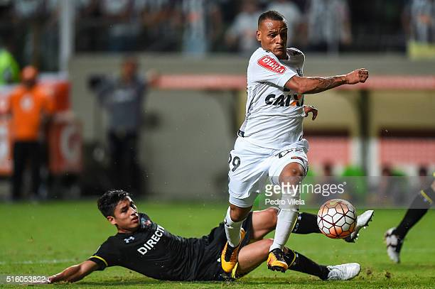 Patric of Atletico MG and Claudio Baeza of Colo Colo battle for the ball during a match between Atletico MG and Colo Colo as part of Copa Bridgestone...