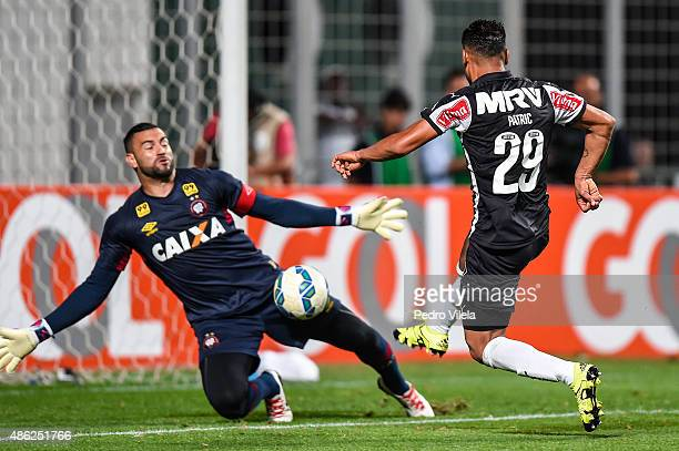 Patric of Atletico MG and Weverton of Atletico PR battle for the ball during a match between Atletico MG and Atletico PR as part of Brasileirao...