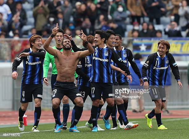Patric of Gamba Osaka celebrates scoring his team's second goal with his team mates during the FUJI XEROX SUPER CUP 2015 match between Gamba Osaka...