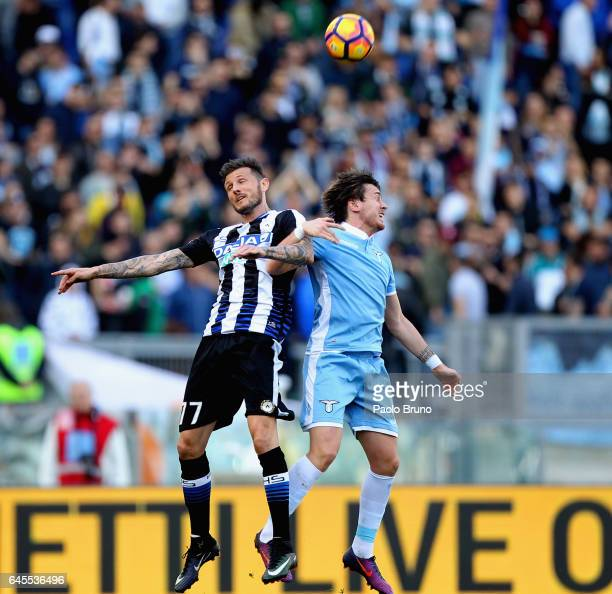 Patric of SS Lazio competes for the ball with Cyril Thereau of Udinese Calcio during the Serie A match between SS Lazio and Udinese Calcio at Stadio...