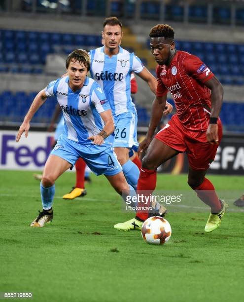 Patric of SSLazio and Aaron Leya Iseka forward of SV Zulte Waregem during the UEFA Europa League Group K stage match between SS Lazio and SV Zulte...