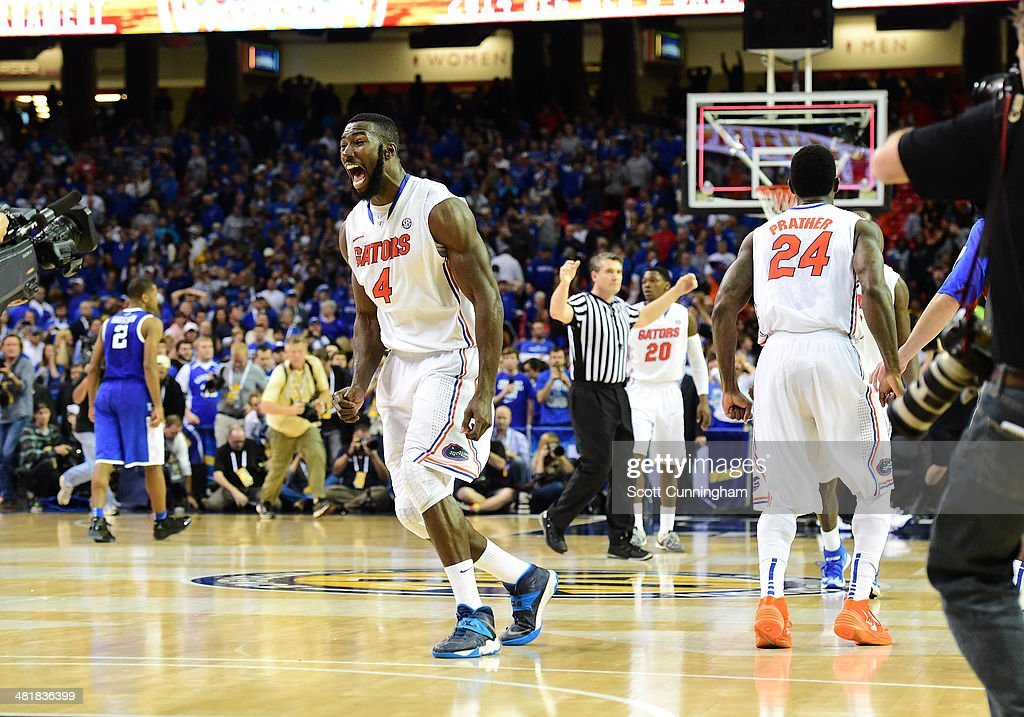 <a gi-track='captionPersonalityLinkClicked' href=/galleries/search?phrase=Patric+Young&family=editorial&specificpeople=7405616 ng-click='$event.stopPropagation()'>Patric Young</a> #4 and <a gi-track='captionPersonalityLinkClicked' href=/galleries/search?phrase=Casey+Prather&family=editorial&specificpeople=7358715 ng-click='$event.stopPropagation()'>Casey Prather</a> #24 celebrate as the horn blows to win the SEC Men's Basketball Tournament against Kentucky Wildcats at the Georgia Dome on March 16, 2014 in Atlanta, Georgia. Photo by Scott Cunningham/Getty Images)