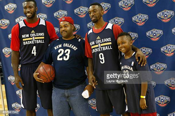 Patric Young and Russ Smith the New Orleans Pelicans pose with fans during an open practice for fans on October 25 2014 at the Smoothie King Center...