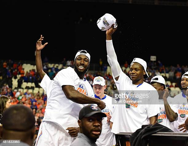 Patric Young and Will Yeguete of the Florida Gators celebrate after the SEC Men's Basketball Tournament against Kentucky Wildcats at the Georgia Dome...