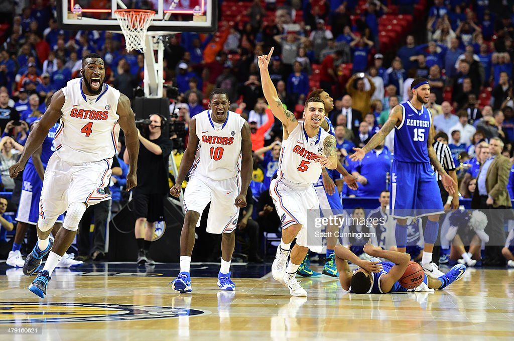 <a gi-track='captionPersonalityLinkClicked' href=/galleries/search?phrase=Patric+Young&family=editorial&specificpeople=7405616 ng-click='$event.stopPropagation()'>Patric Young</a> #4, Dorian Finney-Smith #10, and <a gi-track='captionPersonalityLinkClicked' href=/galleries/search?phrase=Scottie+Wilbekin&family=editorial&specificpeople=7348781 ng-click='$event.stopPropagation()'>Scottie Wilbekin</a> #5 of the Florida Gators celebrate as the horn blows to win the SEC Men's Basketball Tournament against the Kentucky Wildcats at the Georgia Dome on March 16, 2014 in Atlanta, Georgia.
