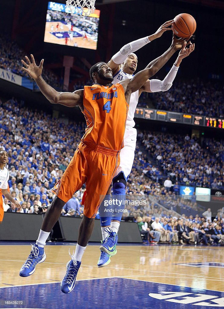 Patric Young #4 of the Florida Gators and Willie Cauley-Stien #15 of the Kentucky Wildcats reach for a rebound at Rupp Arena on March 9, 2013 in Lexington, Kentucky.