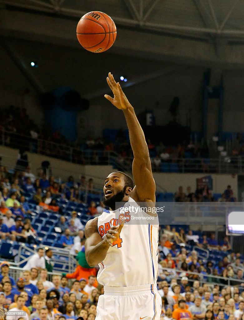 Patric Young #4 of the Florida Gators attempts a shot during the game against the Arkansas Little Rock Trojans at Stephen C. O'Connell Center on November 16, 2013 in Gainesville, Florida.