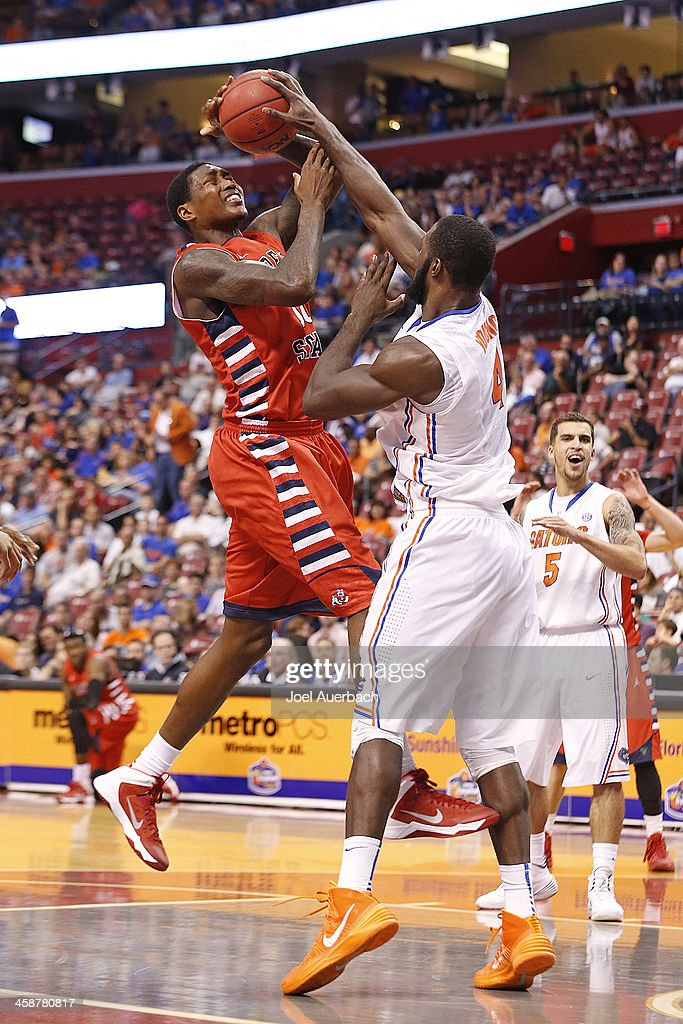 Patric Young #4 of the Florida Gators blocks the shot by Alex Davis #10 of the Fresno State Bulldogs during the MetroPCS Orange Bowl Basketball Classic on December 21, 2013 at the BB&T Center in Sunrise, Florida. Florida defeated Fresno State 66-49.