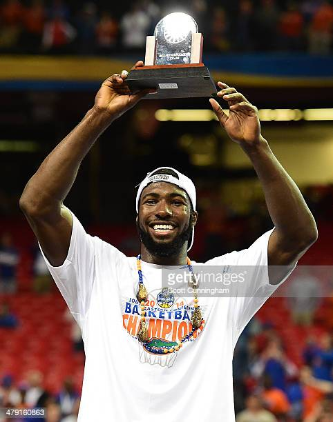 Patric Young of the Florida Gators celebrates being named to the SEC Men's Basketball Tournament AllTournament team after the game against the...