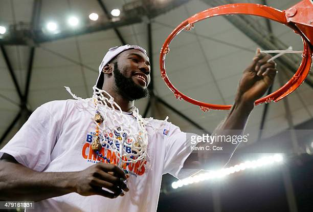 Patric Young of the Florida Gators celebrates by cutting down the net after their 61 to 60 win over the Kentucky Wildcats in the Championship game of...