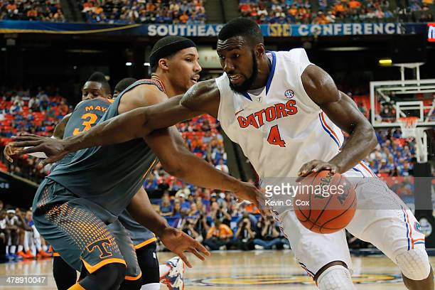 Patric Young of the Florida Gators drives with the ball against Jarnell Stokes of the Tennessee Volunteers during the semifinals of the SEC Men's...