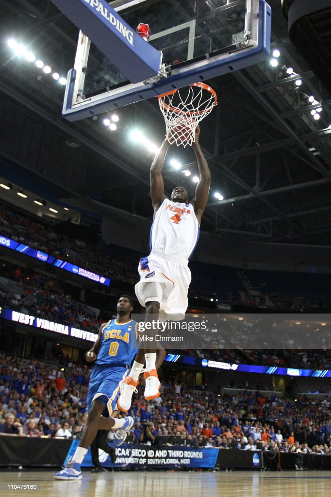 Patric Young of the Florida Gators dunks in the first half against Anthony Stover of the UCLA Bruins during the third round of the 2011 NCAA men's...