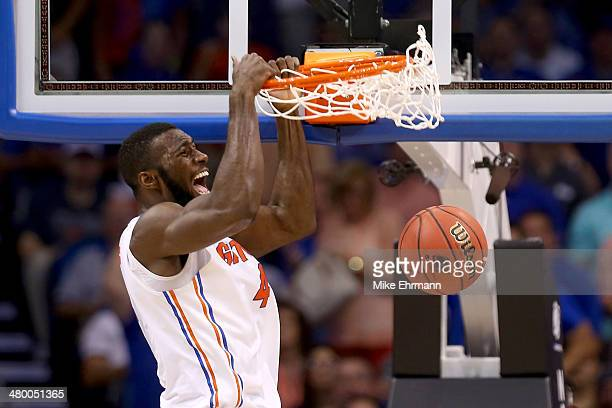 Patric Young of the Florida Gators dunks the ball in the second half while taking on the Pittsburgh Panthers during the third round of the 2014 NCAA...