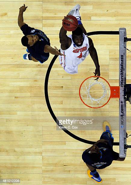 Patric Young of the Florida Gators goes to the basket against the UCLA Bruins during a regional semifinal of the 2014 NCAA Men's Basketball...