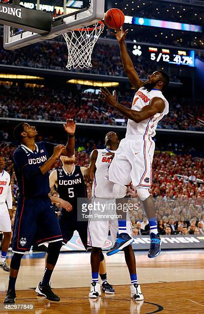 Patric Young of the Florida Gators goes up for a shot against the Connecticut Huskies during the NCAA Men's Final Four Semifinal at ATT Stadium on...
