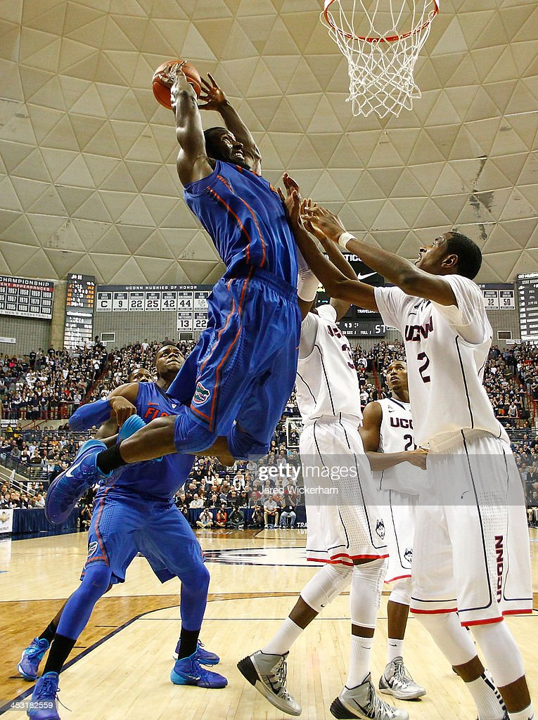 Patric Young #4 of the Florida Gators goes up to dunk the ball in front of DeAndre Daniels #2 of the Connecticut Huskies in the second half during the game at Harry A. Gampel Pavilion on December 2, 2013 in Storrs, Connecticut.